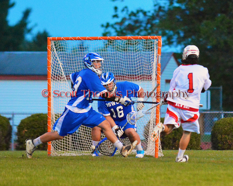 Baldwinsville Bees Zachary Bulak (1) scores against the Oswego Buccaneers in Section III Boys Lacrosse action at the Pelcher-Arcaro Stadium in Baldwinsville, New York.  Baldwinsville won 9-3.