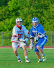 Baldwinsville Bees Matt Zandri (22) and Oswego Buccaneers Adam Doviak (10 battle for the ball in Section III Boys Lacrosse action at the Pelcher-Arcaro Stadium in Baldwinsville, New York.  Baldwinsville won 9-3.