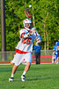 Baldwinsville Bees Ronnie May (26) passing the ball against the Oswego Buccaneers in Section III Boys Lacrosse action at the Pelcher-Arcaro Stadium in Baldwinsville, New York.  Baldwinsville won 9-3.