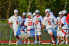 Baldwinsville Bees John Walker (5) with the ball against the Oswego Buccaneers as his teammates look on from the sidelines in Section III Boys Lacrosse action at the Pelcher-Arcaro Stadium in Baldwinsville, New York.  Baldwinsville won 9-3.