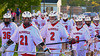 Baldwinsville Bees head to the field after rain delayed the start of the game against the Oswego Buccaneers in Section III Boys Lacrosse action at the Pelcher-Arcaro Stadium in Baldwinsville, New York.  Baldwinsville won 9-3.