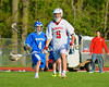 Baldwinsville Bees John Walker (5) bringing the ball upfield against the Oswego Buccaneers in Section III Boys Lacrosse action at the Pelcher-Arcaro Stadium in Baldwinsville, New York.  Baldwinsville won 9-3.