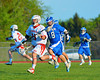 Baldwinsville Bees Scott Kirchner (11) outrunning Oswego Buccaneers Chase Izyk (18) in Section III Boys Lacrosse action at the Pelcher-Arcaro Stadium in Baldwinsville, New York.  Baldwinsville won 9-3.