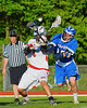 Baldwinsville Bees Zachary Bulak (1) gets the ball knocked out by Oswego Buccaneers Jon Buske (15) in Section III Boys Lacrosse action at the Pelcher-Arcaro Stadium in Baldwinsville, New York.  Baldwinsville won 9-3.
