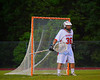 Baldwinsville Bees Bradley Johnston (36) mans the net against the Oswego Buccaneers in Section III Boys Lacrosse action at the Pelcher-Arcaro Stadium in Baldwinsville, New York.  Baldwinsville won 9-3.