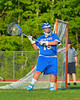 Oswego Buccaneers goalie Trey Love (16) getting ready to pass the ball up field against the Baldwinsville Bees in Section III Boys Lacrosse action at the Pelcher-Arcaro Stadium in Baldwinsville, New York.  Baldwinsville won 9-3.