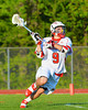 Baldwinsville Bees Stephen Petrelli (9) heading towards the Oswego Buccaneers net in Section III Boys Lacrosse action at the Pelcher-Arcaro Stadium in Baldwinsville, New York.  Baldwinsville won 9-3.