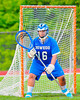 Oswego Buccaneers Trey Love (16) guarding his net against the Baldwinsville Bees in Section III Boys Lacrosse action at the Pelcher-Arcaro Stadium in Baldwinsville, New York.  Baldwinsville won 9-3.