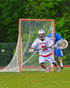 Baldwinsville Bees goalie Matt Colclough (31) watches an Oswego Buccaneers shot go wide of his net in Section III Boys Lacrosse action at the Pelcher-Arcaro Stadium in Baldwinsville, New York.  Baldwinsville won 9-3.