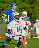 Baldwinsville Bees Austin McAskill (17) carrying the ball against the Oswego Buccaneers in Section III Boys Lacrosse action at the Pelcher-Arcaro Stadium in Baldwinsville, New York.  Baldwinsville won 9-3.