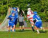Oswego Buccaneers goalie Trey Love (16) makes a save on a shot by Baldwinsville Bees Sean Barron (24) in Section III Boys Lacrosse action at the Pelcher-Arcaro Stadium in Baldwinsville, New York.  Baldwinsville won 9-3.