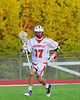 Baldwinsville Bees Austin McAskill (17) with the ball against the Oswego Buccaneers in Section III Boys Lacrosse action at the Pelcher-Arcaro Stadium in Baldwinsville, New York.  Baldwinsville won 9-3.