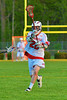 Baldwinsville Bees Ronnie May (26) playing against the Oswego Buccaneers in Section III Boys Lacrosse action at the Pelcher-Arcaro Stadium in Baldwinsville, New York.  Baldwinsville won 9-3.