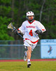 Baldwinsville Bees Dylan Bowman (4) playing against the Oswego Buccaneers in Section III Boys Lacrosse action at the Pelcher-Arcaro Stadium in Baldwinsville, New York.  Baldwinsville won 9-3.
