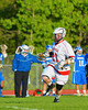 Baldwinsville Bees Matthew Paddock (21) brings the ball upfield against the Oswego Buccaneers in Section III Boys Lacrosse action at the Pelcher-Arcaro Stadium in Baldwinsville, New York.  Baldwinsville won 9-3.