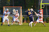 West Genesee Wildcats Teddy Glesener (21) fires in a goal past Baldwinsville Bees defenders Tyler Gornick (27), Parker Ferrigan (23) and Matthew Paddock (21) in Section III Boys Lacrosse action at the Pelcher-Arcaro Stadium in Baldwinsville, New York. West Genesee won 9-6.