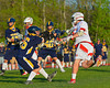 Baldwinsville Bees Kyle Akers (25) fires in a goal past West Genesee Wildcats defenders in Section III Boys Lacrosse action at the Pelcher-Arcaro Stadium in Baldwinsville, New York.