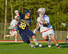West Genesee Wildcats Garrett Waldron (32) checks Baldwinsville Bees Zachary Bulak (1) in Section III Boys Lacrosse action at the Pelcher-Arcaro Stadium in Baldwinsville, New York. West Genesee won 9-6.