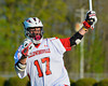 Baldwinsville Bees Austin McAskill (17) celebrates his goal against the West Genesee Wildcats in Section III Boys Lacrosse action at the Pelcher-Arcaro Stadium in Baldwinsville, New York.