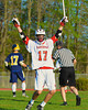 Baldwinsville Bees Austin McAskill (17) celebrates a goal against the West Genesee Wildcats in Section III Boys Lacrosse action at the Pelcher-Arcaro Stadium in Baldwinsville, New York.