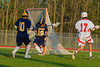 West Genesee Wildcats goalie Matt Koziol (19) makes one of his 15 saves on a shot by Baldwinsville Bees Austin McAskill (17) in Section III Boys Lacrosse action at the Pelcher-Arcaro Stadium in Baldwinsville, New York. West Genesee won 9-6.