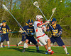Baldwinsville Bees Stephen Petrelli (9) fires in a goal over West Genesee Wildcats defenders in Section III Boys Lacrosse action at the Pelcher-Arcaro Stadium in Baldwinsville, New York.