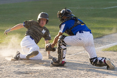 Middletown's Jack Higgs beats the tag from Meriden's Brandon Hernandez at home Wednesday at Palmer Field in Middletown Jul. 5, 2017 | Justin Weekes / For the Record-Journal