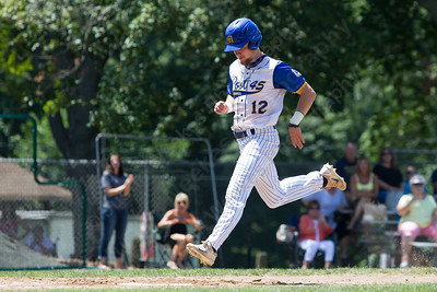 Meriden Post's 45 Jeffrey Massicotte lands on home plate scoring the winning run over East Haven Sunday during the second round of the American Legion tournament at Legion Field in Meriden Jul. 16, 2017 | Justin Weekes / For the Record-Journal