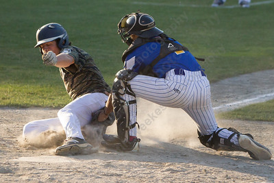 Meriden's Brandon Hernandez tags Middletown's Luke Garofalo out at home Wednesday at Palmer Field in Middletown Jul. 5, 2017 | Justin Weekes / For the Record-Journal