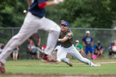 Meriden's Jeffrey Massicotte dives for a fly ball from Cheshire's Ryan Strollo Saturday at Legion Field in Meriden Jul. 8, 2017 | Justin Weekes / For the Record-Journal