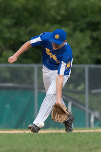 Meriden's Post 45 Elliot Good charges a short hit from Wallingford's Post 187 Sam DeMaio Tuesday at Pat Wall Field in Wallingford. The game was postponed in the third inning due to weather tied 2 -2. Jun. 27, 2017 | Justin Weekes / For the Record-Journal