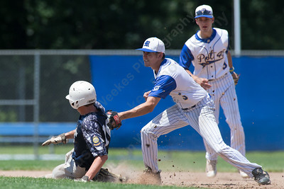 Meriden Post's 45 James Pellegrino catches East Haven's Dominic DelBasso steeling Sunday during the second round of the American Legion tournament at Legion Field in Meriden Jul. 16, 2017 | Justin Weekes / For the Record-Journal