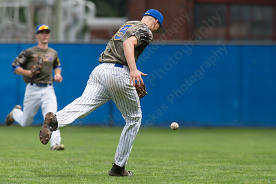 Meriden's Elliot Good chases a fly ball in foul territory Saturday at Legion Field in Meriden Jul. 8, 2017 | Justin Weekes / For the Record-Journal