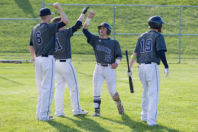Lyman Hall's Mike Caruso gets congratulations after scoring Monday at Neubauer Field in Wallingford May. 9, 2016 | Justin Weekes / For the Record-Journal