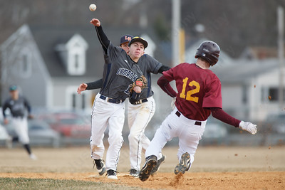 Lyman Hall's Tucker Fredricksen turns the double play Thursday at Westside Field in Wallingford April 5, 2018 | Justin Weekes / Special to the Record-Journal