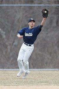 Lyman Hall's Ethan Day catches a fly ball in left field Wednesday during a pre-season scrimmage at Pat Wall Field in Wallingford March 28, 2018 | Justin Weekes / Special to the Record-Journal