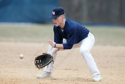 Lyman Hall's Jack McDonald field a ground ball at first base Wednesday during a pre-season scrimmage at Pat Wall Field in Wallingford March 28, 2018 | Justin Weekes / Special to the Record-Journal