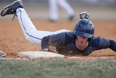 Lyman Hall's Brennan Toussaint dives back to first Thursday at Westside Field in Wallingford April 5, 2018 | Justin Weekes / Special to the Record-Journal