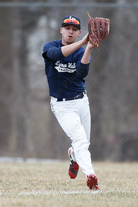 Lyman Hall's Tyler Lyons catches a fly ball Wednesday during a pre-season scrimmage at Pat Wall Field in Wallingford March 28, 2018 | Justin Weekes / Special to the Record-Journal
