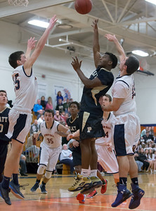 Platt's Kejoun West puts up a shot in the lane Tuesday at Lyman Hall High School in Wallingford The Platt Panthers defeated the Lyman Hall Trojans 93 to 79.December,27 2016 © 2016 Justin Weekes