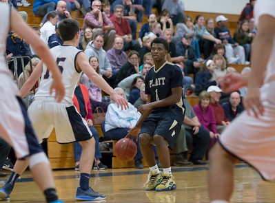 Platt's Kejoun West looks for a hole to pass Tuesday at Lyman Hall High School in Wallingford The Platt Panthers defeated the Lyman Hall Trojans 93 to 79.December,27 2016 © 2016 Justin Weekes