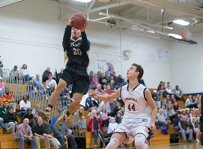 Platt's Tylon Papallo puts in a layup after a steal Tuesday at Lyman Hall High School in Wallingford The Platt Panthers defeated the Lyman Hall Trojans 93 to 79.December,27 2016 © 2016 Justin Weekes