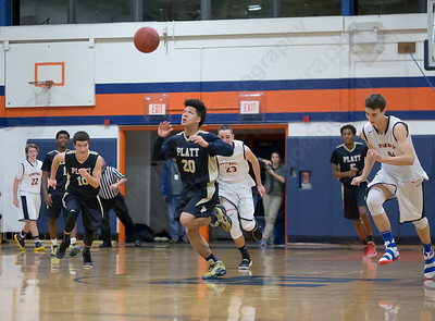 Platt's Tylon Papallo chases a loose ball Tuesday at Lyman Hall High School in Wallingford The Platt Panthers defeated the Lyman Hall Trojans 93 to 79.December,27 2016 © 2016 Justin Weekes