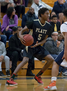 Platt's Isaiah Jones looks to pass Tuesday at Lyman Hall High School in Wallingford The Platt Panthers defeated the Lyman Hall Trojans 93 to 79.December,27 2016 © 2016 Justin Weekes