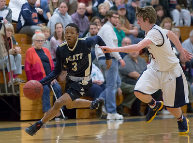 Platt's Bryant Washington dribbles past Lyman Hall's Kevin Ransom Tuesday at Lyman Hall High School in Wallingford The Platt Panthers defeated the Lyman Hall Trojans 93 to 79.December,27 2016 © 2016 Justin Weekes
