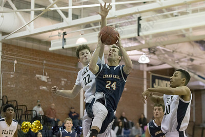 Lyman Hall's Jake Ranney puts up a shot as Platt's Carson Coon defends Monday at Platt High School in Meriden December 18, 2017 | Justin Weekes / For the Record-Journal