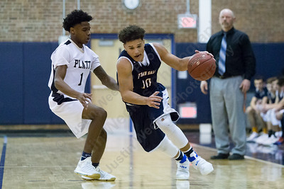 Lyman Hall's Shakespeare Rodriguez works past Platt's Tremayne Carter Monday at Platt High School in Meriden December 18, 2017 | Justin Weekes / For the Record-Journal