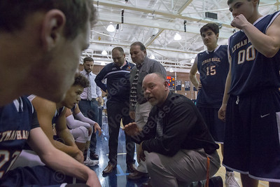 Lyman Hall's head coach talks with players after shutting out Platt in the first quarter 17 to 0 Monday at Platt High School in Meriden December 18, 2017 | Justin Weekes / For the Record-Journal