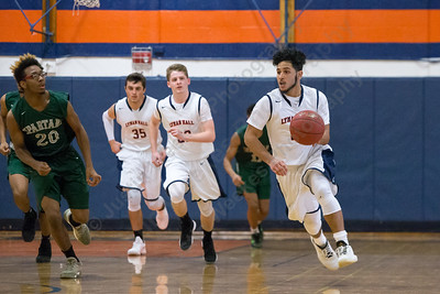 Lyman Hall's Austin Ruiz pushes up court on a fast break Thursday at Lyman Hall High School in Wallingford December 28, 2017 | Justin Weekes / Special to the Record-Journal