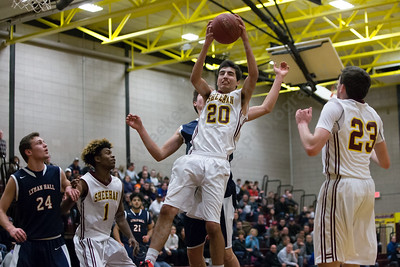 Sheehan's Brett Gill come down with a rebound Saturday at Sheehan High School in Wallingford January 6, 2018 | Justin Weekes / Special to the Record-Journal